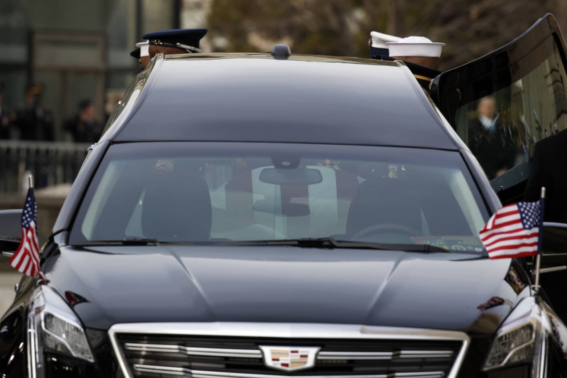 WASHINGTON, DC - DECEMBER 05: (AFP OUT) The flag-draped casket of former President George H.W. Bush is carried by a joint services military honor guard into a hearse after a State Funeral at the Washington National Cathedral on December 5, 2018 in Washington, DC. President Bush will be buried at his final resting place at the George H.W. Bush Presidential Library at Texas A&M University in College Station, Texas. A WWII combat veteran, Bush served as a member of Congress from Texas, ambassador to the United Nations, director of the CIA, vice president and 41st president of the United States. (Photo by Alex Brandon - Pool/Getty Images)