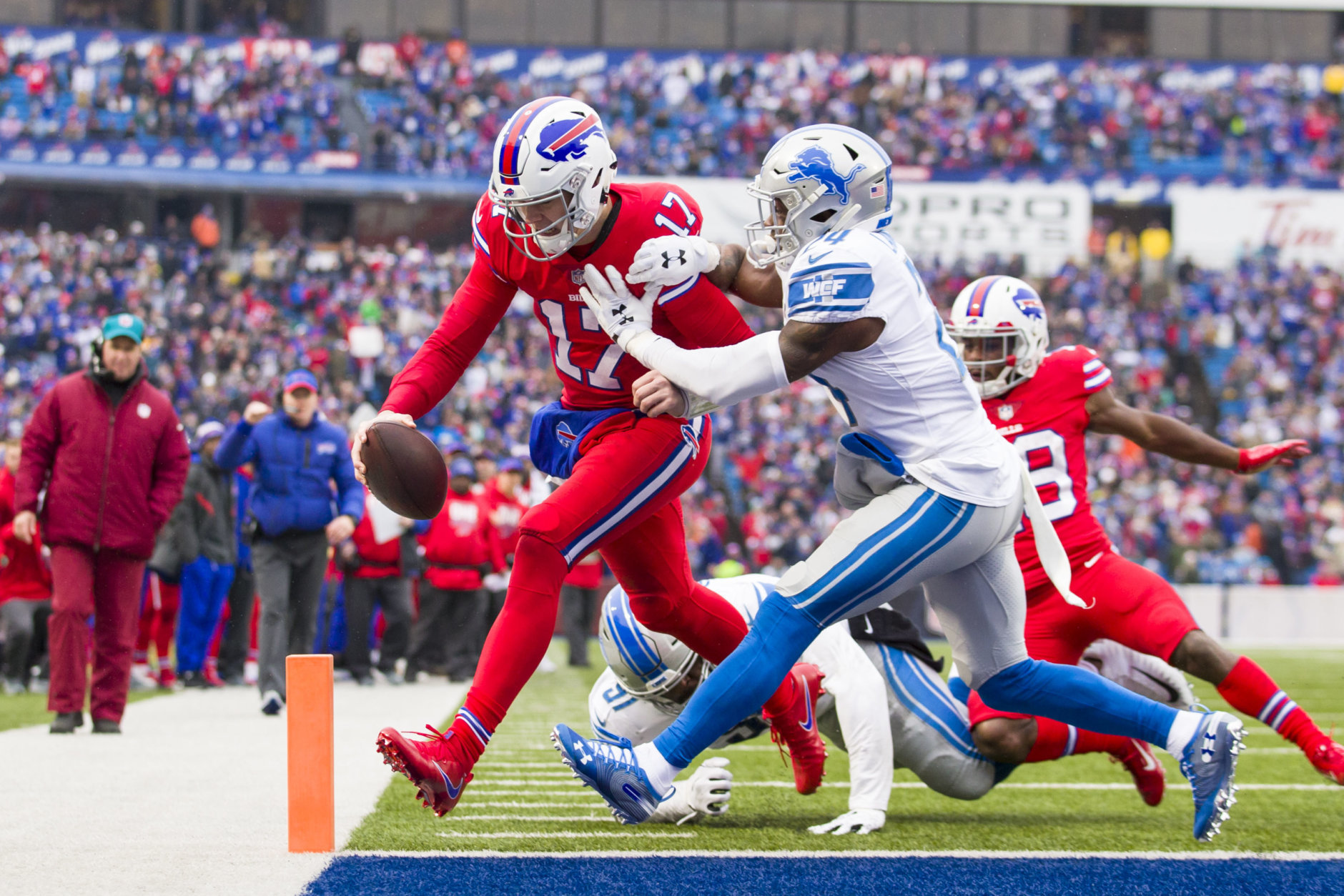 ORCHARD PARK, NY - DECEMBER 16:  Josh Allen #17 of the Buffalo Bills carries the ball for a touchdown  during the second quarter against the Detroit Lions at New Era Field on December 16, 2018 in Orchard Park, New York.  (Photo by Brett Carlsen/Getty Images)