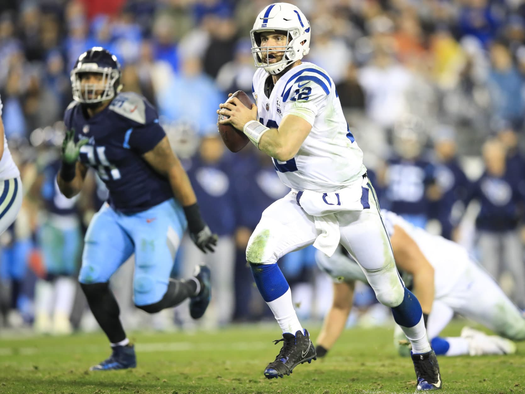 NASHVILLE, TN - DECEMBER 30: Andrew Luck #12 of the Indianapolis Colts runs with the ball against the Tennessee Titans during the fourth quarter at Nissan Stadium on December 30, 2018 in Nashville, Tennessee. (Photo by Andy Lyons/Getty Images)