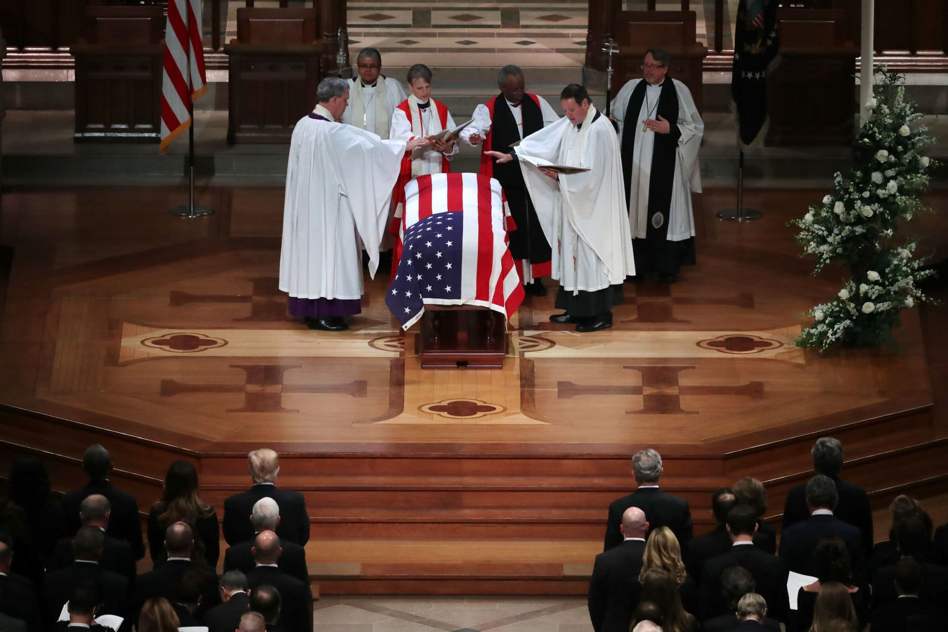 WASHINGTON, DC - DECEMBER 05:  Clergy pray over former President George H.W. Bush's flag-draped casket during his state funeral at the National Cathedral December 05, 2018 in Washington, DC. A WWII combat veteran, Bush served as a member of Congress from Texas, ambassador to the United Nations, director of the CIA, vice president and 41st president of the United States.  (Photo by Chip Somodevilla/Getty Images)