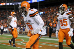DENVER, COLORADO - DECEMBER 15: Quarterback Baker Mayfield #6 of the Cleveland Browns celebrates a touchdown against the Denver Broncos at Broncos Stadium at Mile High on December 15, 2018 in Denver, Colorado. (Photo by Matthew Stockman/Getty Images)