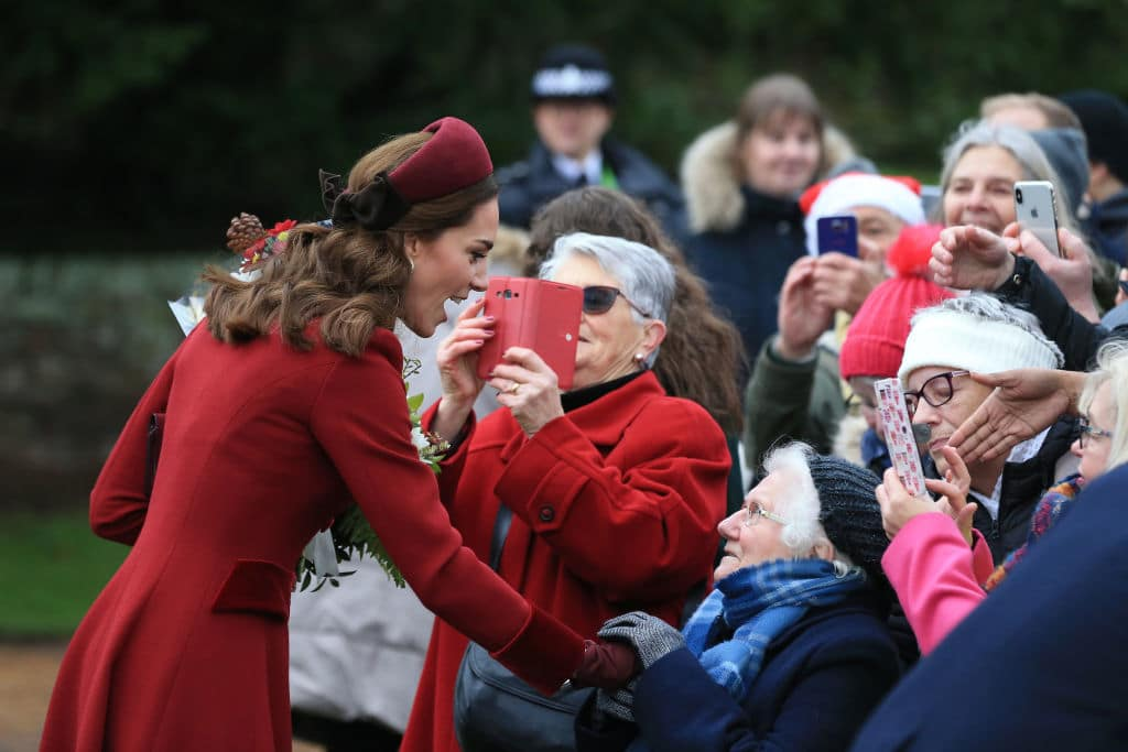 KING'S LYNN, ENGLAND - DECEMBER 25: Catherine, Duchess of Cambridge greets well wishers as she attend Christmas Day Church service at Church of St Mary Magdalene on the Sandringham estate on December 25, 2018 in King's Lynn, England. (Photo by Stephen Pond/Getty Images)