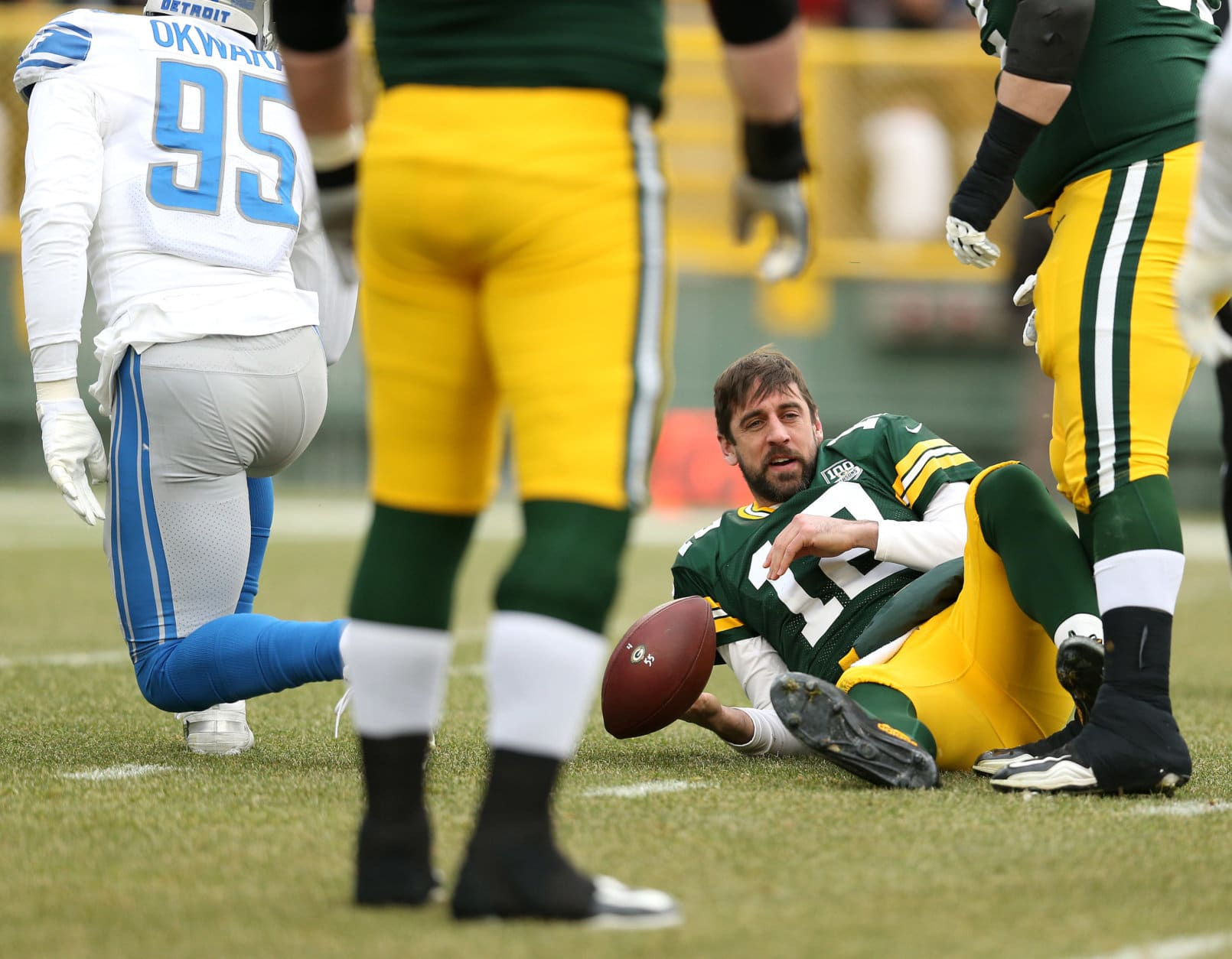 GREEN BAY, WISCONSIN - DECEMBER 30: Aaron Rodgers #12 of the Green Bay Packers lays on the ground after being sacked by Romeo Okwara #95 of the Detroit Lions during the first half of a game at Lambeau Field on December 30, 2018 in Green Bay, Wisconsin. (Photo by Dylan Buell/Getty Images)