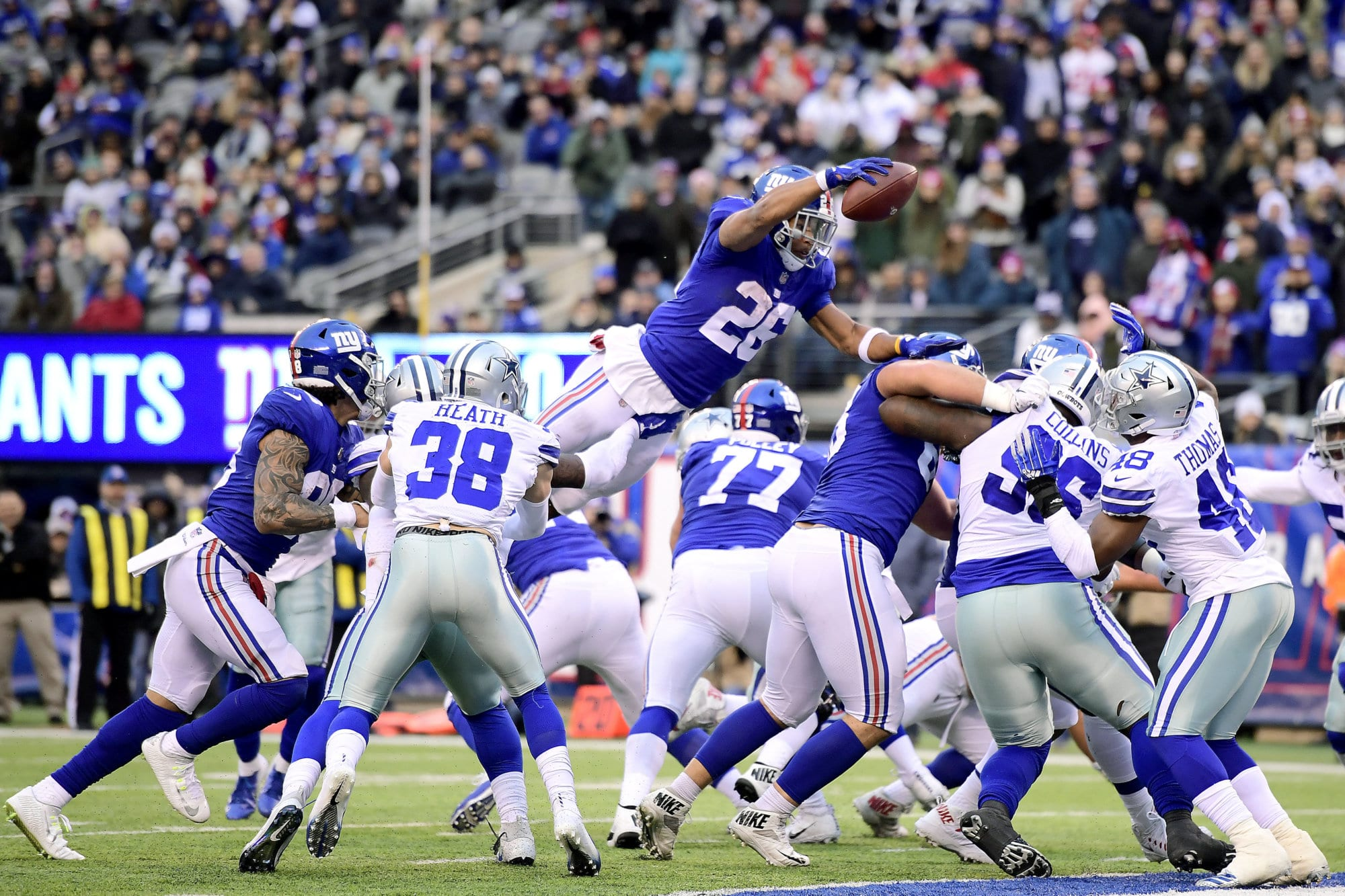 EAST RUTHERFORD, NEW JERSEY - DECEMBER 30:  Saquon Barkley #26 of the New York Giants dives across the goal-line for a fourth quarter touchdown against the Dallas Cowboys at MetLife Stadium on December 30, 2018 in East Rutherford, New Jersey. (Photo by Steven Ryan/Getty Images)