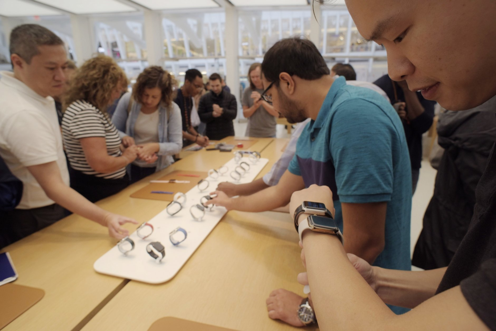 FILE- In this Sept. 21, 2018, file photo customers look at new Apple watches including the Series 4 at an Apple store in New York. The new Apple Watch model, called Series 4, has built-in EKG sensors so you can share detailed heart readings with your doctor without visiting a clinic. Doctors get a PDF file showing the peaks and valleys of your heart rhythm, just as they would with an EKG on paper. (AP Photo/Patrick Sison, File)