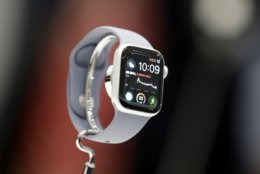 FILE - In this Sept. 12, 2018, file photo the new Apple Watch 4 is on display at the Steve Jobs Theater during an event to announce new products in Cupertino, Calif. The latest Apple Watch, for instance, has several features that will be useful to the elderly and less-active individuals. That includes built-in EKG sensors so you can share detailed heart readings with your doctor without visiting a clinic. (AP Photo/Marcio Jose Sanchez, File)