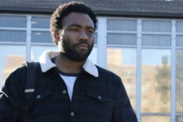 "This image released by FX shows Donald Glover in a scene from the comedy series ""Atlanta."" On Thursday, Dec. 6, 2018, Glover was nominated for a Golden Globe award for lead actor in a comedy series for his role in the series. The 76th Golden Globe Awards will be held on Sunday, Jan. 6.  (Curtis Baker/FX via AP)"