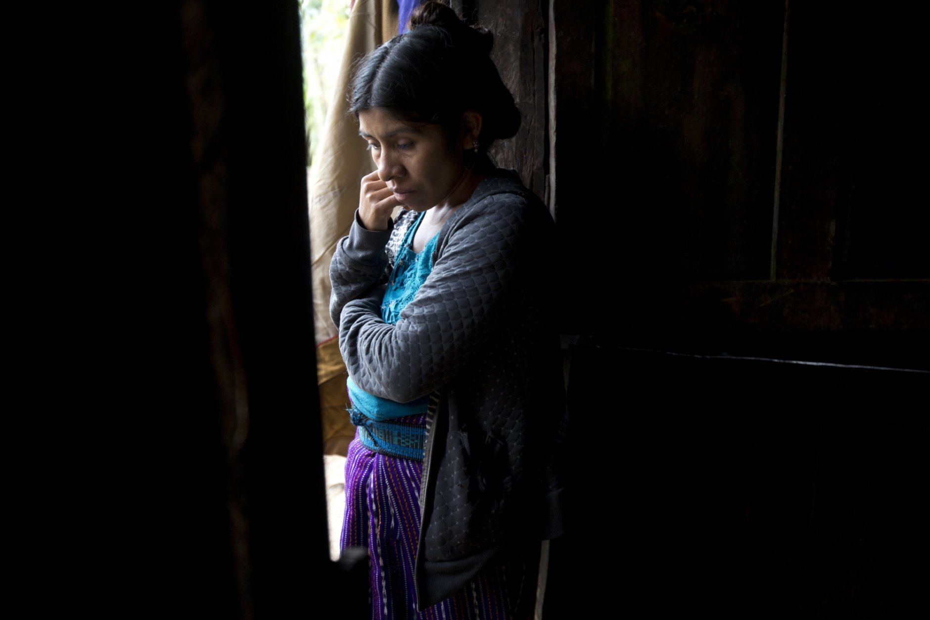 Catarina Alonzo Perez, mother of the second Guatemalan child this month to die while in U.S. custody, stands in her kitchen in Yalambojoch, Guatemala, Saturday, Dec. 29, 2018. Felipe was healthy when they left, according to the family. The last time he spoke with his mother was a day before they were taken into detention by border agents. Felipe told his mother that he was fine. (AP Photo/Moises Castillo)