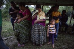 Family members attend a memorial service for 7-year-old granddaughter Jakelin Caal Maquin, in San Antonio Secortez, Guatemala, Monday, Dec. 24, 2018. The body of the 7-year-old girl who died while in the custody of the U.S. Border Patrol was handed over to family members in her native Guatemala on Monday for a last goodbye. (AP Photo/ Oliver de Ros)