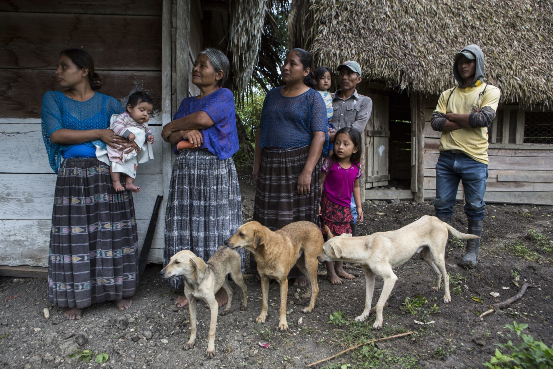 Members of the Caal Maquin family and neighbors stand in front of Claudia Maquin's house in Raxruha, Guatemala, on Saturday, Dec. 15, 2018. Claudia Maquin's daughter, 7-year-old Jakelin Amei Rosmery Caal, died in a Texas hospital, two days after being taken into custody by border patrol agents in a remote stretch of New Mexico desert. (AP Photo/Oliver de Ros)