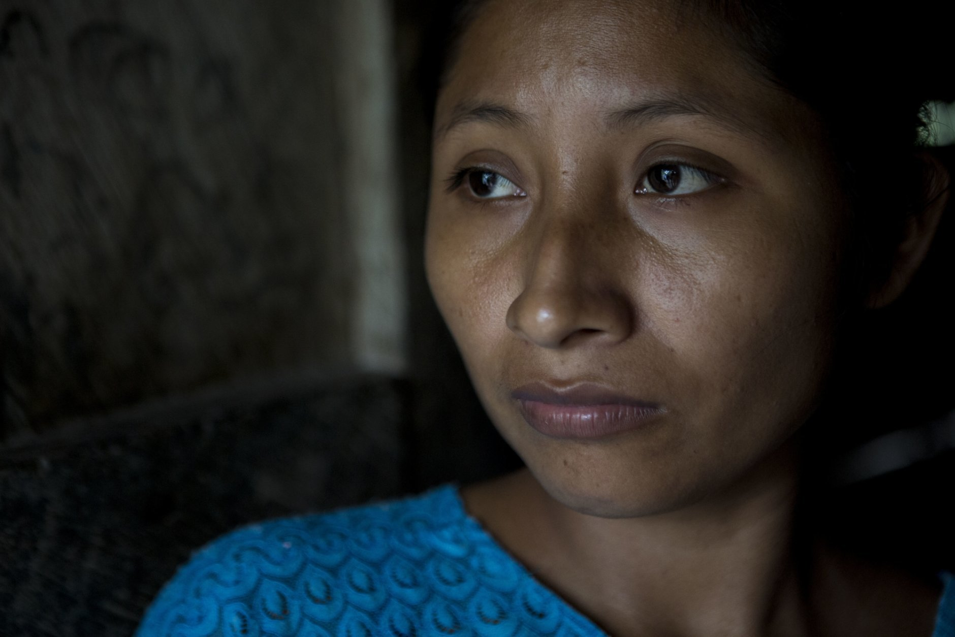 Claudia Maquin, 27, poses for a portrait at her house in Raxruha, Guatemala, on Saturday, Dec. 15, 2018. Claudia Maquin's daughter, 7-year-old Jakelin Amei Rosmery Caal, died in a Texas hospital, two days after being taken into custody by border patrol agents in a remote stretch of New Mexico desert. (AP Photo/Oliver de Ros)