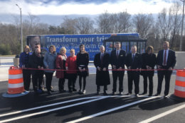 While transit launches can sometimes be slow to get off the ground, Prince William County Del. Danica Roem, at center, said many of the riders on the first buses believe it will save them significant time, money and stress amid years of Interstate 66 toll lane construction. (WTOP/Max Smith)