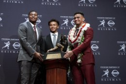 Heisman Trophy finalists, from left, Dwayne Haskins, from Ohio State; Kyler Murray, from Oklahoma; and Tua Tagovailoa, from Alabama, pose with the tophy during a media event Saturday, Dec. 8, 2018, in New York. (AP Photo/Craig Ruttle)