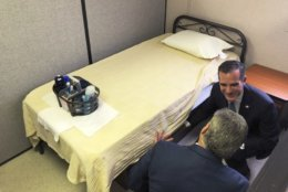 """FILE - In this Sept. 5, 2018, file photo, Mayor Eric Garcetti, top, get a tour from John Maceri, executive director of The People Concern, the facility's contracted nonprofit operator of a downtown """"Bridge Home,"""" first of what is planned to be a citywide network of temporary housing sites for homeless people at a news conference in Los Angeles. A new federal report says the number of people living on the streets in Los Angeles and San Diego, two epicenters of a West Coast homelessness crisis, fell this year, suggesting possible success in those cities' efforts to combat the problem. Homelessness overall was up slightly across the country, although the report did not provide a complete picture of the problem. (AP Photo/Ariel Tu, File)"""