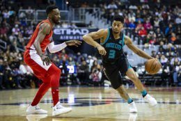 Charlotte Hornets guard Jeremy Lamb (3) drives against Washington Wizards forward Jeff Green during the first half of an NBA basketball game Saturday, Dec. 29, 2018, in Washington. (AP Photo/Al Drago)