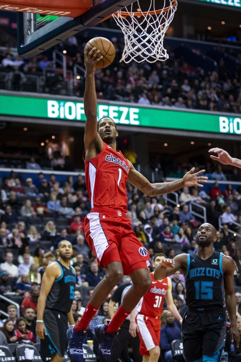 Washington Wizards forward Trevor Ariza (1) attempts a layup past Charlotte Hornets guard Kemba Walker (15) during the second half of an NBA basketball game Saturday, Dec. 29, 2018, in Washington. Washington won 130-126. (AP Photo/Al Drago)