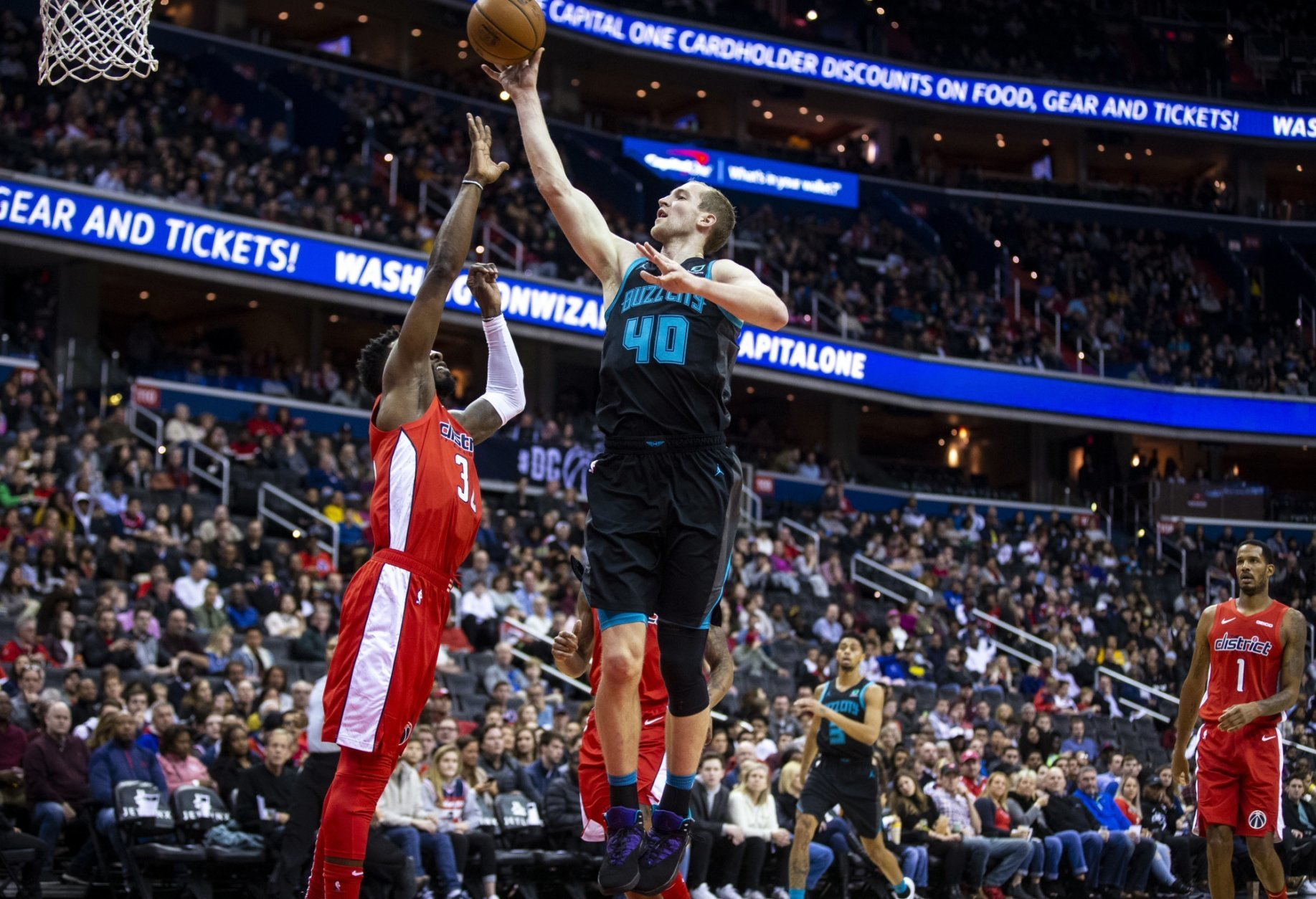 Charlotte Hornets center Cody Zeller (40) shoots over Washington Wizards forward Jeff Green (32) during the first half of an NBA basketball game Saturday, Dec. 29, 2018, in Washington. (AP Photo/Al Drago)