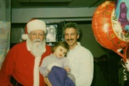 Olivia and her father Mike Lang with Santa in 2001. Olivia had recently survived a crash that left her with serious injuries and caused her to be hospitalized for more than a month. (Courtesy / Kelly Lang)