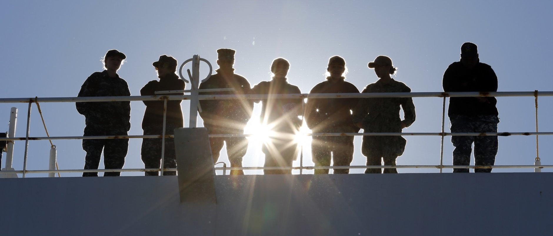 Navy personnel line the rails as the US Navy Hospital Ship USNS Comfort arrives pier side at Naval Station Norfolk, Tuesday, Dec. 18, 2018, in Norfolk , Va., after an 11-week medical support mission to South and Central America. The ship treated over 26,000 patients and conducted approximately 600 surgeries. (AP Photo/Steve Helber)