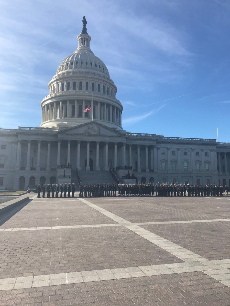 Members of the military line up before the arrival of the late president at the U.S. Capitol on Monday. (WTOP/Mitchell Miller)