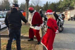 Santa gets ready to make his way across Montgomery County to collect and deliver toys on Wednesday. (WTOP/Melissa Howell)