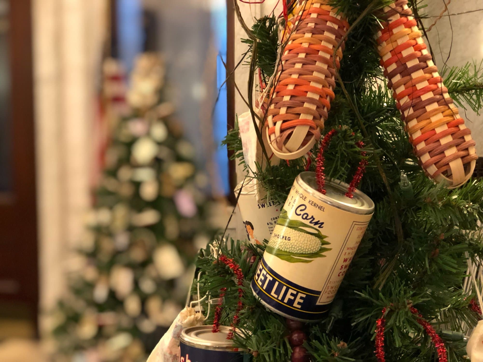 This Harford County, Md.-themed tree is decked with vintage produce cans, which reference the county's agricultural and manufacturing history. From the 1880s to the 1950s there were 700 canneries in Harford County alone. (WTOP/Kate Ryan)