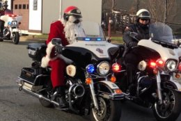 The jolly elf ditched the reindeer for Wednesday's gift run. In their place was an escort of 30 police officers on motorcycles. (WTOP/Melissa Howell)