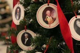The governors of Maryland are featured on this tree decorated by the Chestertown Garden Club, part of a display of Christmas trees on view at the Maryland State House in Annapolis, Md. (WTOP/Kate Ryan)
