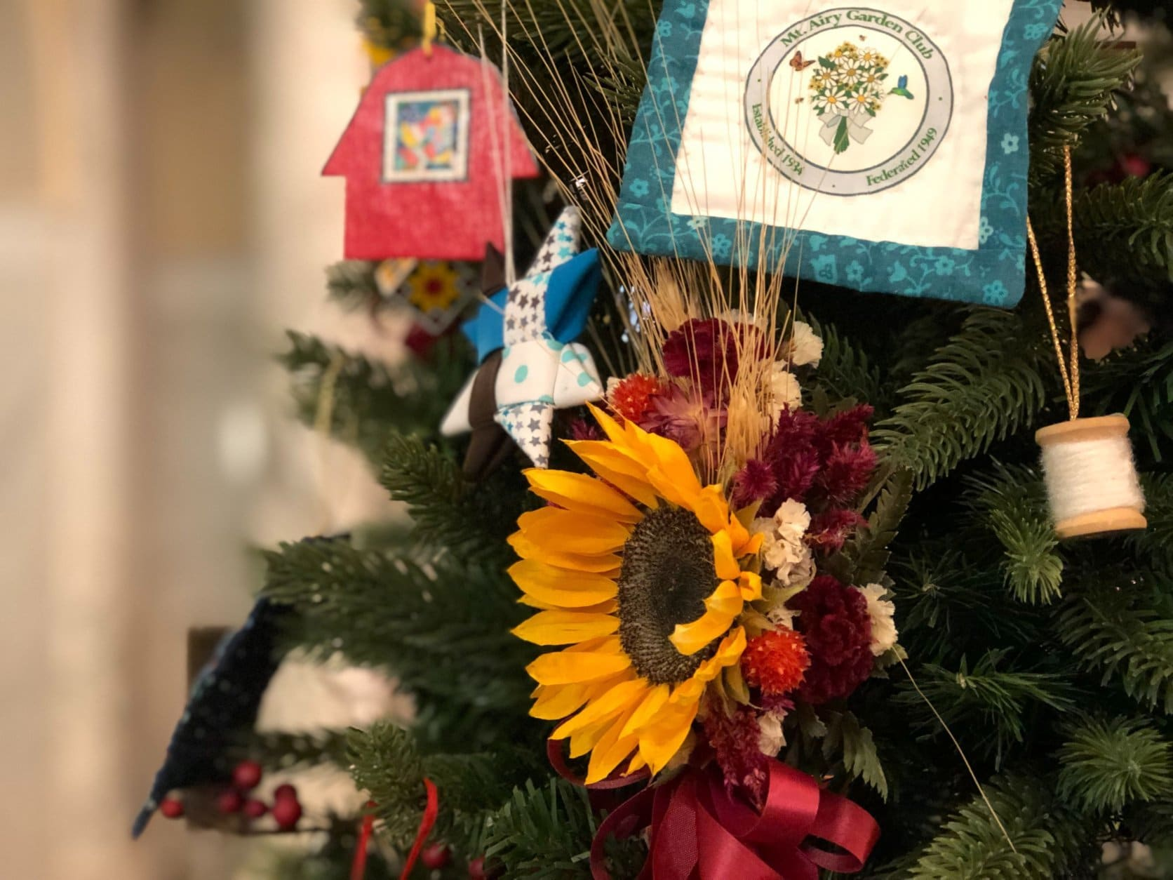 This tree deocorated by the Mt. Airy Garden Club features some of the symbols of Maryland's rural heritage. The tree is part of a display on view at Maryland's State House in Annapolis, Md., through Jan. 3, 2019. (WTOP/Kate Ryan)
