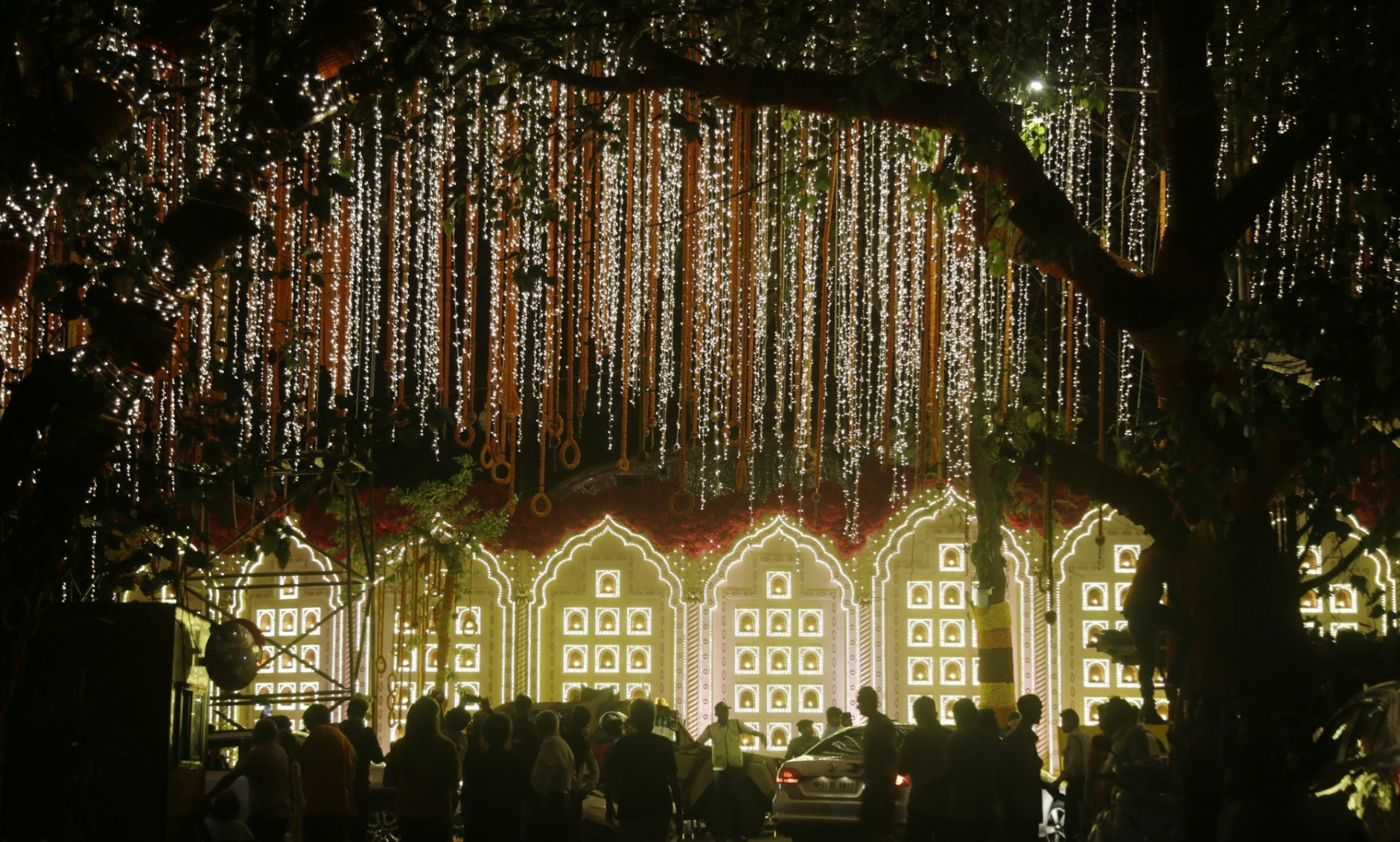 A street is lit-up outside the house of Reliance Industries Chairman Mukesh Ambani ahead of the wedding of his daughter Isha in Mumbai, India, Tuesday, Dec. 11, 2018. Isha Ambani, the daughter of India's richest mogul, is to wed Anand Piramal, the son of one of India's biggest industrialists, at the Ambani estate in Mumbai on Wednesday, capping off an extravagant days-long event. (AP Photo/Rajanish Kakade)