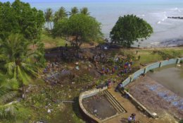 In this Monday, Dec. 24, 2018, photo, a view of a beach resort is seen after a tsunami in Tanjung Lesung, Indonesia. The tsunami that hit the coasts of Indonesian islands along the Sunda Strait was not big but it was destructive. The waves smashed onto beaches in the darkness Saturday night without warning, ripping houses and hotels from their foundations in seconds and sweeping terrified concertgoers into the sea.(AP Photo/Achmad Ibrahim)