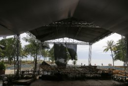 This Monday, Dec. 24, 2018, photo shows a stage destroyed by Saturday's tsunami at a beach resort in Tanjung Lesung, Indonesia. The tsunami that hit the coasts of Indonesian islands along the Sunda Strait was not big but it was destructive. The waves smashed onto beaches in the darkness Saturday night without warning, ripping houses and hotels from their foundations in seconds and sweeping terrified concertgoers into the sea. (AP Photo/Achmad Ibrahim)