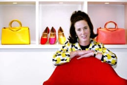FILE - In this May 13, 2004 file photo, designer Kate Spade poses with handbags and shoes from her next collection in New York. Law enforcement officials say Tuesday, June 5, 2018, that New York fashion designer Kate Spade has been found dead in her apartment in an apparent suicide. (AP Photo/Bebeto Matthews, File)