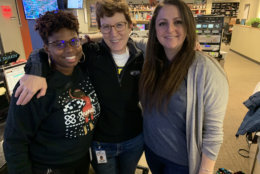 WTOP editor Judy Taub flanked by editor Letese' Clark and digital editor Lisa Weiner on Taub's last day, Dec. 21, 2018. (WTOP/Mark Lewis)
