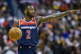 FILE -- Washington Wizards guard John Wall (2) dribbles the ball during the second half of an NBA basketball game, Sunday, Dec. 16, 2018, in Washington. Washington won 128-1110. (AP Photo/Al Drago)