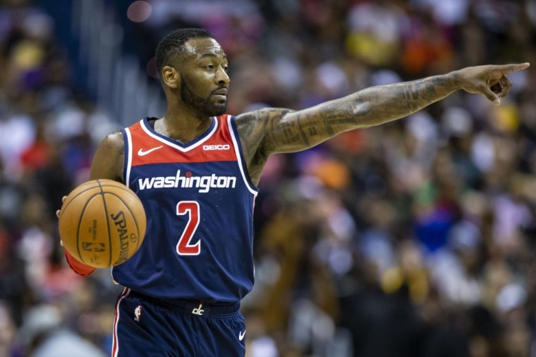 Wizards' John Wall out with heel injury, will see specialist