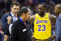 Los Angeles Lakers forward LeBron James (23) and head coach Luke Walton dispute a call during the first half of an NBA basketball game, Sunday, Dec. 16, 2018, in Washington. (AP Photo/Al Drago)