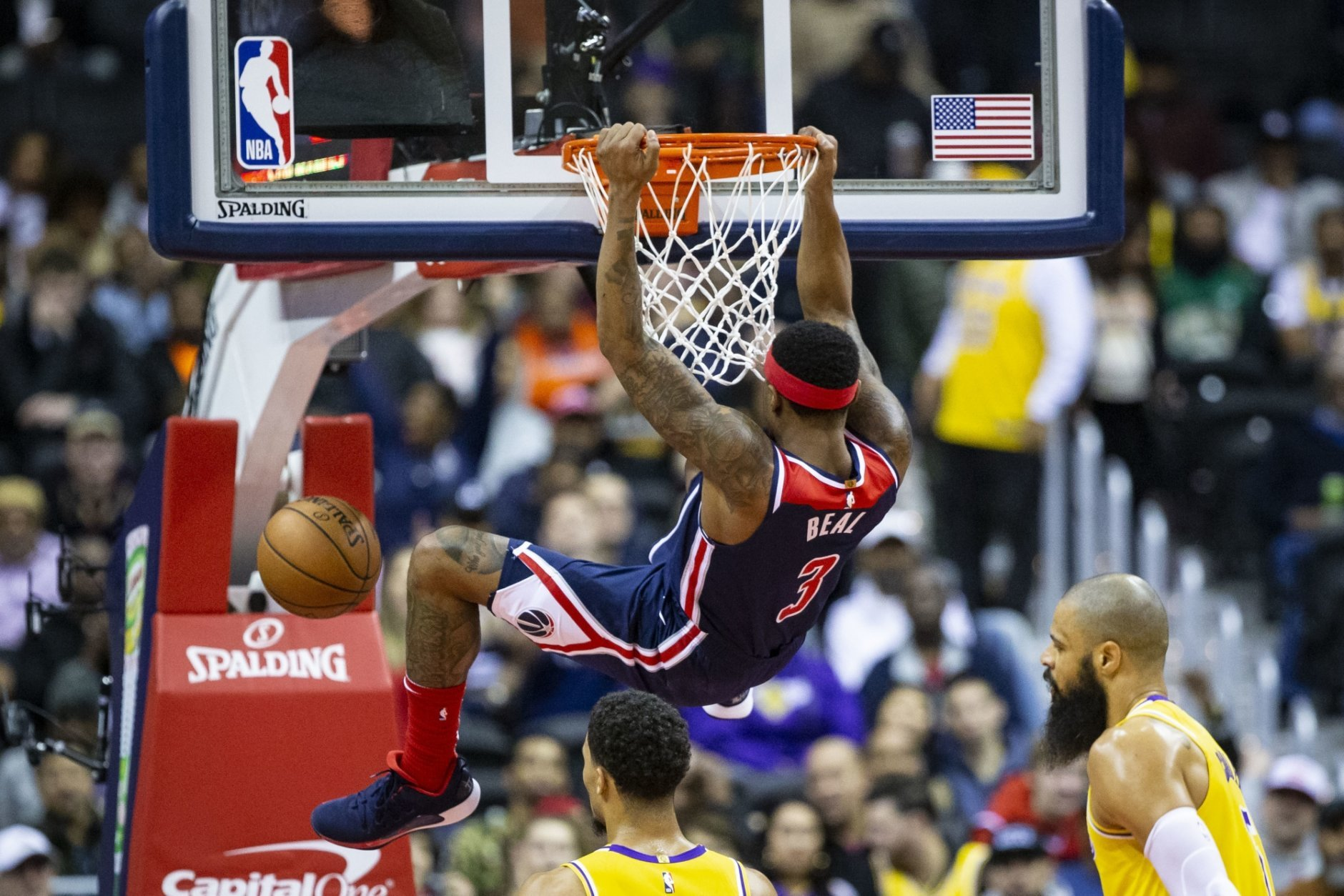 Washington Wizards guard Bradley Beal (3) dunks the ball during the first half of an NBA basketball game, Sunday, Dec. 16, 2018, in Washington. (AP Photo/Al Drago)