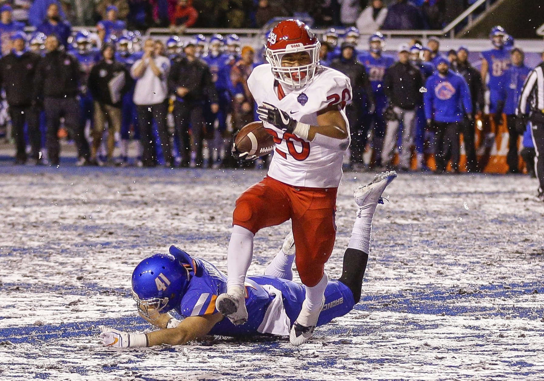 Fresno State running back Ronnie Rivers (20) runs past the diving tackle attempt by Boise State linebacker Will Heffner (41) for a touchdown in overtime in an NCAA college football game for the Mountain West championship, Saturday, Dec. 1, 2018, in Boise, Idaho. Fresno State won 19-16. (AP Photo/Steve Conner)