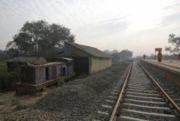 In this Nov. 29, 2018 photo, an old train engine is seen next to the newly built train tracks connecting the 34 kilometers (21 miles) between Janakpur in southeastern Nepal and Jay Nagar in the Indian state of Bihar at Janakpur in Nepal. The competition between two Asian giants, India and China, for influence over tiny Nepal is yielding a bonanza in the form of the Himalayan mountain nation's first modern railway, and possibly more to come. (AP Photo/Niranjan Shrestha)