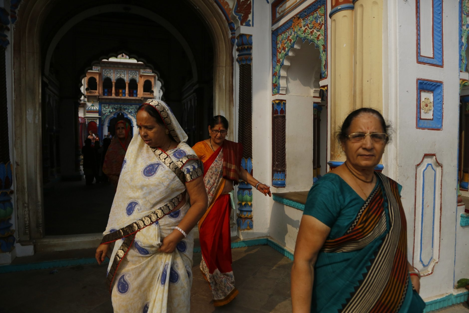 In this Nov. 30, 2018 photo, Indian tourists visit  the Ram Janaki temple in Janakpur, Nepal. Millions of Hindu devotees travel every year to the temple where the Hindu goddess Sita is believed to have been born and later married the Hindu god Ram. A new rail line connecting the 34 kilometers (21 miles) between Janakpur in southeastern Nepal and Jay Nagar in the Indian state of Bihar are raising hopes for new business and pilgrimages. (AP Photo/Niranjan Shrestha)