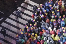 Revelers wait for midnight during the New Year's Eve celebration in New York's Times Square, as seen from above from the Marriott Marquis hotel, Monday, Dec. 31, 2018, in New York. (AP Photo/Frank Franklin II)