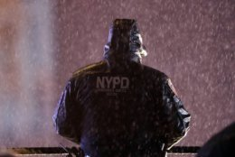 A member of the New York Police Department watches over revelers as they wait for midnight during the New Year's Eve celebration in New York's Times Square, Monday, Dec. 31, 2018, in New York. (AP Photo/Frank Franklin II)