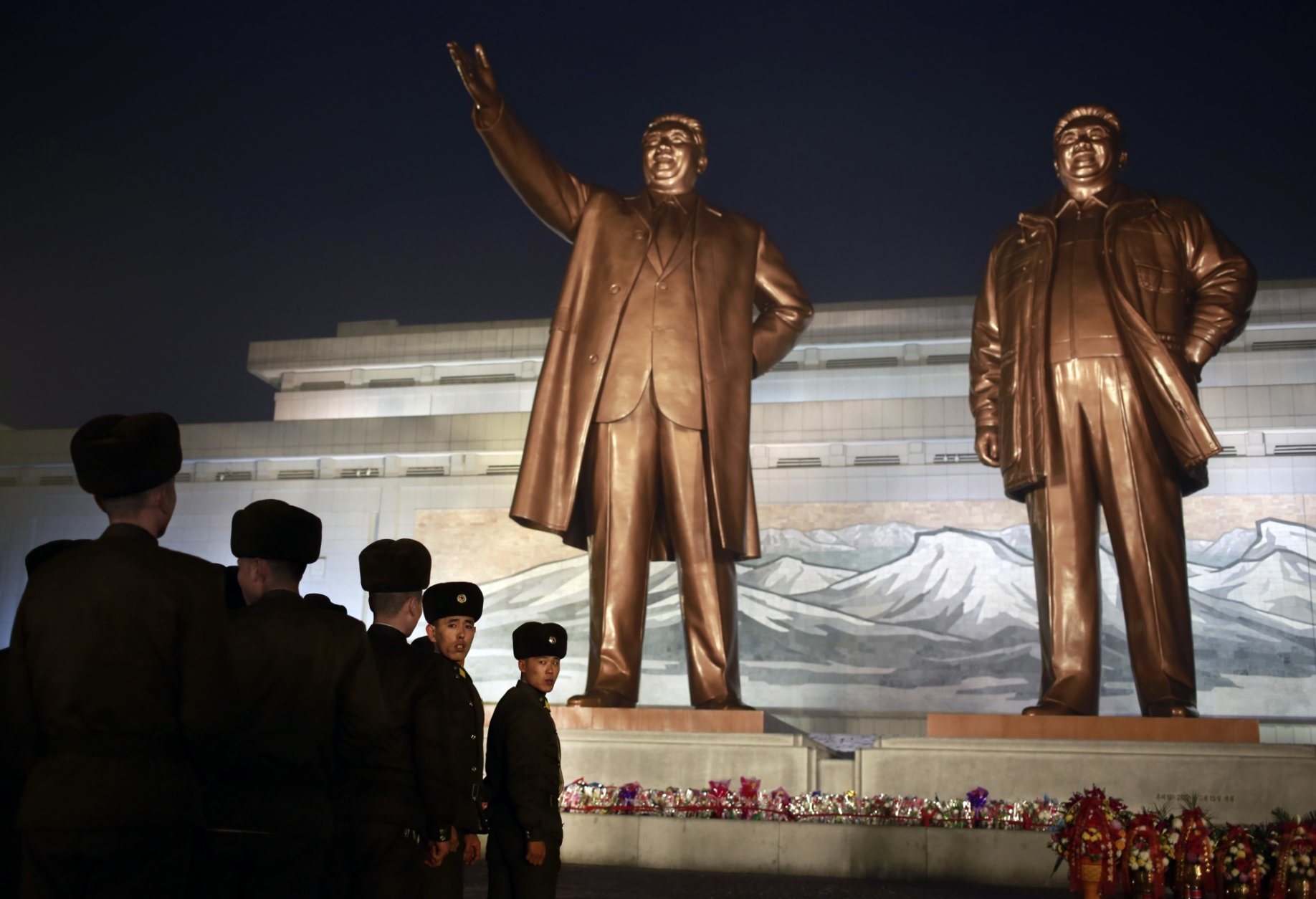 North Korean soldiers line up as they pay respect to the bronze statues of their late leaders Kim Il Sung and Kim Jong Il at Mansu Hill Grand Monument in Pyongyang, North Korea, Sunday, Dec. 16, 2018. Many North Koreans are marking the seventh anniversary of the death of leader Kim Jong Il with visits to the statues and vows of loyalty to his son, Kim Jong Un. (AP Photo/Dita Alangkara)