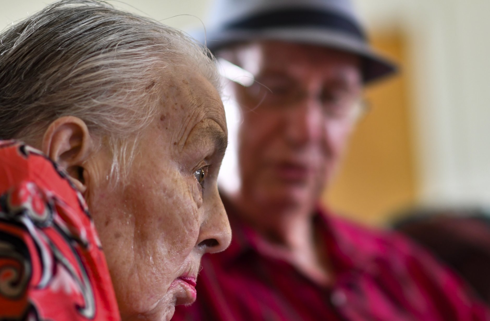 In this Tuesday, Aug. 21, 2018 photo, Jackie West, 86, of Eaton Rapids, listens as her husband Don, 90, sings to her during their anniversary party at the adult foster care home in Charlotte, Mich., where she has lived since a stroke in June of 2017. (Matthew Dae Smith/Lansing State Journal via AP)