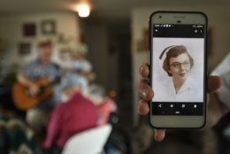 In this Tuesday, Aug. 21, 2018 photo a picture of retired nurse Jackie West taken at about the time she met Don West, her husband of 64 years, is shown at the adult foster care home in Charlotte, Mich., where she has lived since a stroke in June of 2017. (Matthew Dae Smith/Lansing State Journal via AP)