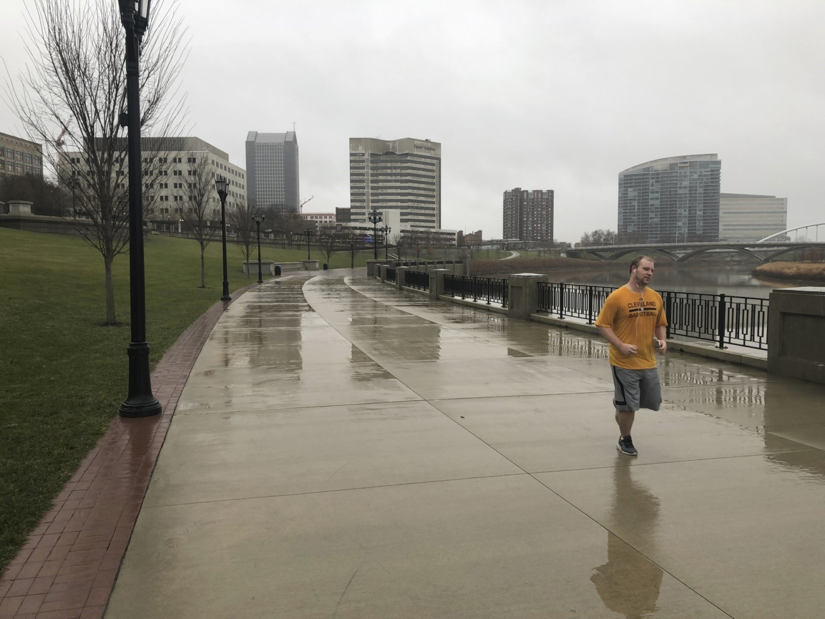 Evan Miller, 31, finishes up a 6 ½-mile run along the downtown Scioto River in mist and 53 degrees on Friday, Dec. 28, 2018, in Columbus, Ohio. In contrast to other parts of the country, Ohio saw unusually mild temperatures Friday with readings in the 50s for many cities. (AP Photo/Andrew Welsh-Huggins)