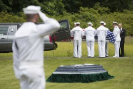 FILE - In this June 9, 2018, file photo, a casket containing the remains of U.S. Navy Seaman 1st Class Edward Slapikas, a Newport Twp., Pa. native killed while serving aboard the USS Oklahoma in the Japanese attack on Pearl Harbor in Dec. 1941, is taken from a hearse during a burial service at St. Mary's Cemetery in Nanticoke, Pa. Slapikas' remains were identified earlier this year and returned to Luzerne County for burial 77 years after his death. Advances in DNA technology mean previously unidentified US sailors and Marines killed at Pearl Harbor are finally being laid to rest in their hometowns. (Christopher Dolan/The Citizens' Voice via AP, File)