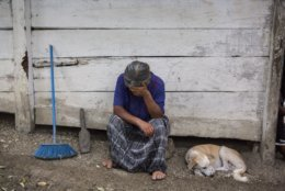 Elvira Choc, 59, Jakelin Amei Rosmery Caal's grandmother, rests her head on her hand in front of her house in Raxruha, Guatemala, on Saturday, Dec. 15, 2018. The 7-year old girl died in a Texas hospital, two days after being taken into custody by border patrol agents in a remote stretch of New Mexico desert. (AP Photo/Oliver de Ros)