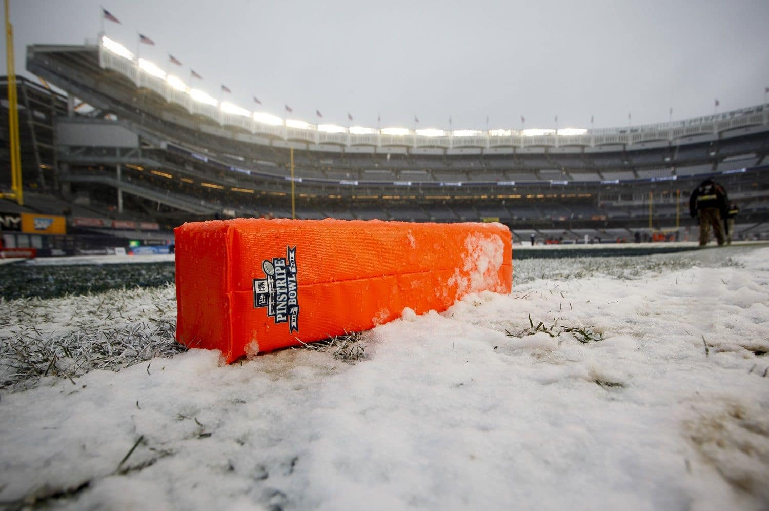 NEW YORK, NY - DECEMBER 29:  A goal marker lies in the snow before the New Era Pinstripe Bowl between West Virginia Mountaineers and the Syracuse Orange at Yankee Stadium on December 29, 2012 in the Bronx borough of New York City.  (Photo by Jeff Zelevansky/Getty Images)